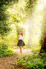 Portrait of beautiful young woman in a forest