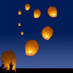 heart symbol from lanterns at night