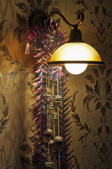 Wall lamp, decorated with Christmas lights.