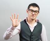 Man shows five fingers