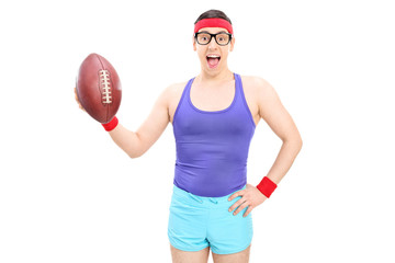 Excited nerdy guy holding a football