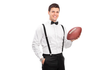 Stylish man holding a football