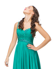 Portrait of young woman in evening green dress