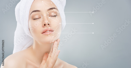 applying cosmetic cream - 77138623