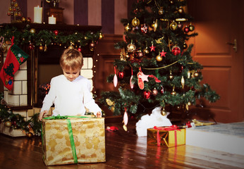 little boy with presents at christmas