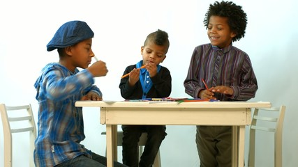 children draw at the table, fool around, laughing