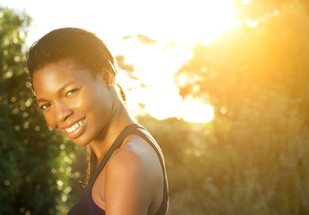 Happy african american woman smiling outdoors
