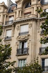 facade of typical house with balcony in Paris, France