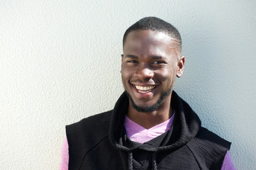 Happy young african american man smiling