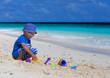 child building sandcastle on the beach