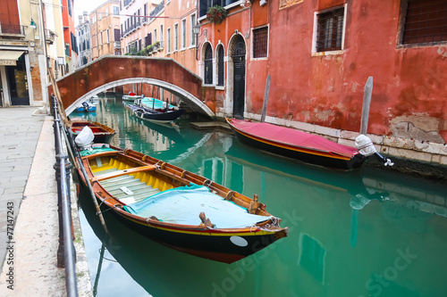 Gondolas parked in water canal - 77147243