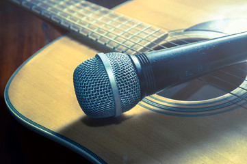 Microphone on acoustic guitar,vintage filtered.