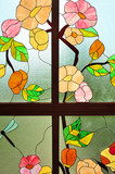 Bright floral pattern on a stained glass window - 77149476