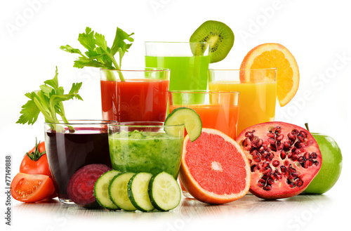 Glasses with fresh organic vegetable and fruit juices on white - 77149888