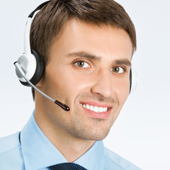 Phone operator in headset, on grey