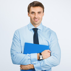 Business man with folder, on grey