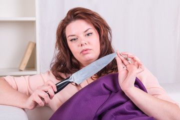 Woman murderer plans to murder with a knife