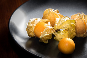 Physalis fruit or capegooseberry on plate.