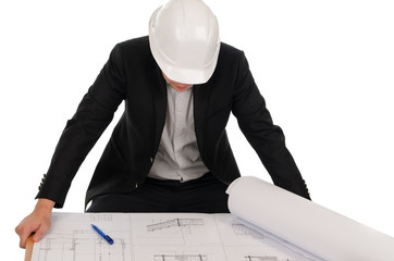 Male Engineer Reviewing the Blueprint at the Table