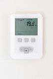 Thermostat on white wall