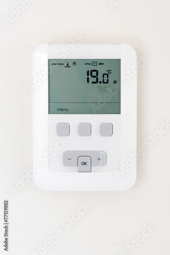 Thermostat on white wall - 77159882