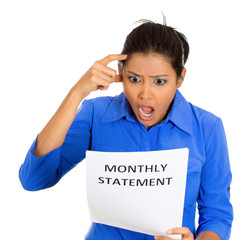 woman disgusted at monthly statement on white background