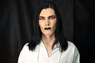 Portrait of man with make up