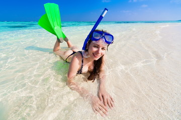 Maldives, women  with flippers, mask