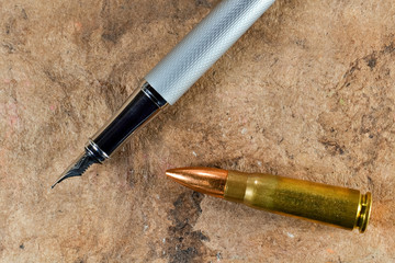Pen and bullet