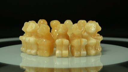 Carved aragonite monkeys rotating