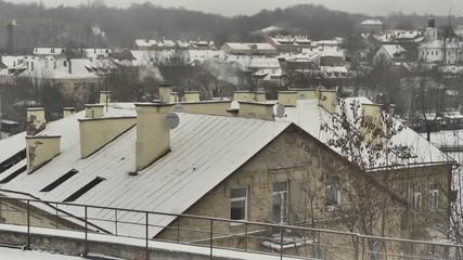 Vilnius. Winter. Snow-covered roof. Сhimneys smoke. Time lapse