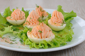 Eggs stuffed with salmon pate in lettuce leaves