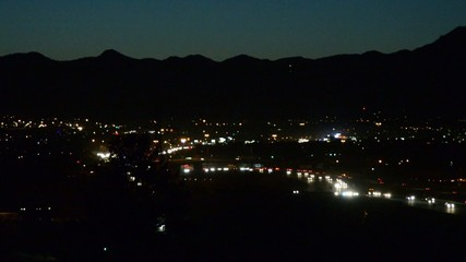 Freeway traffic entering the city from the mountains at dusk
