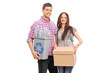 Couple holding a box and a recycle bin