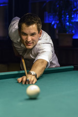 smiling young male billiard player