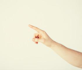 man hand pointing at something