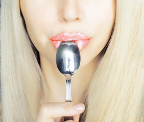 girl with spoon in mouth