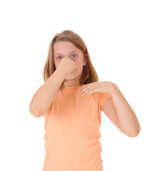 Girl holding her nose.