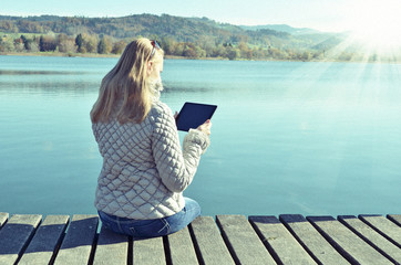 Girl reading from a tablet
