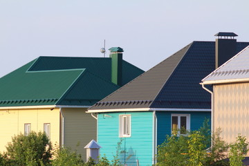 Cottages with colorful roofs against a blue sky