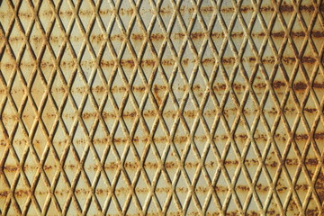 Old painted and rusted rhombic metal wall surface
