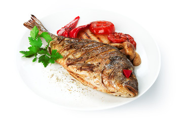 Restaurant food isolated - whole grilled dorado with tomatoes an