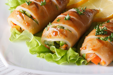Grilled squid stuffed with vegetables on lettuce. Horizontal