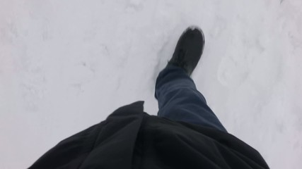 POV walk on snow covered road in park