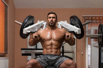 Bodybuilder Exercising Shoulders