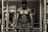 Bodybuilder Doing Trapezius Exercise poster