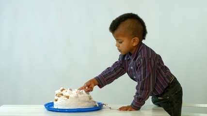 small african eat cake with hands