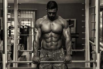Bodybuilder Doing Trapezius Exercise