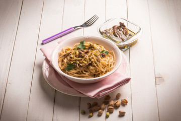 spaghetti with anchovies and pistachio nuts