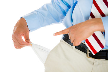 Closeup man pulling out empty pockets penniless